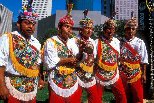 Stock photo of a group of five men in traditional clothing at the International Festival in downtown Houston Texas