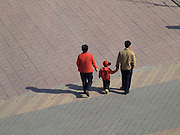 Chinese family walking Beijing China
