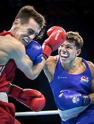 Northern Ireland's Aidan Walsh (red) v England's Pat McCormack (blue) during the Men's Welter (69kg) final at Oxenford Studios during day ten of the 2018 Commonwealth Games in the Gold Coast, Australia.