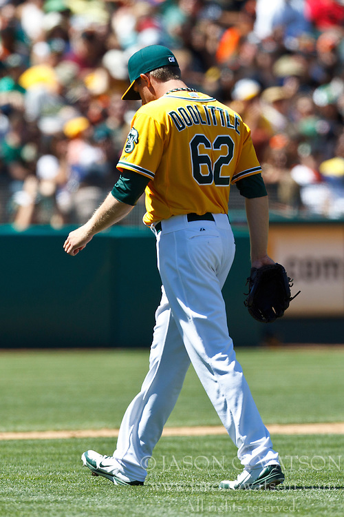 OAKLAND, CA - JUNE 24: Sean Doolittle #62 of the Oakland Athletics returns to the dugout after being relieved during the eighth inning of an interleague game against the San Francisco Giants at O.co Coliseum on June 24, 2012 in Oakland, California.  The Oakland Athletics defeated the San Francisco Giants 4-2. (Photo by Jason O. Watson/Getty Images) *** Local Caption *** Sean Doolittle