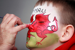 A young Wales fan has his face painted with Y Ddraig Goch (The Red Dragon), the flag of Wales during the Guinness Six Nations match at the Principality Stadium, Cardiff.