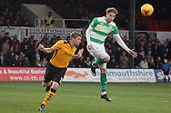 Newport's Scot Bennett and Yeovil's Ryan Bird challenge for the aerial ball. Skybet football league two match, Newport county v Yeovil Town at Rodney Parade in Newport, South Wales on Saturday 21st November 2015.<br /> pic by David Richards, Andrew Orchard sports photography.