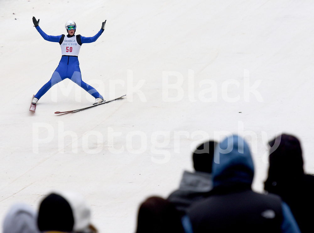 Ville Korhonen celebrates after making a jump during the Norge Winter Ski Jump Tournament in Fox River Grove on Sunday, Jan. 28, 2018.
