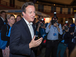 © Licensed to London News Pictures . 30/09/2014 . Birmingham , UK . DAVID CAMERON at the LBC stand this morning after being interviewed by Nick Ferrari . The 2014 Conservative Party Conference in Birmingham . Photo credit : Joel Goodman/LNP