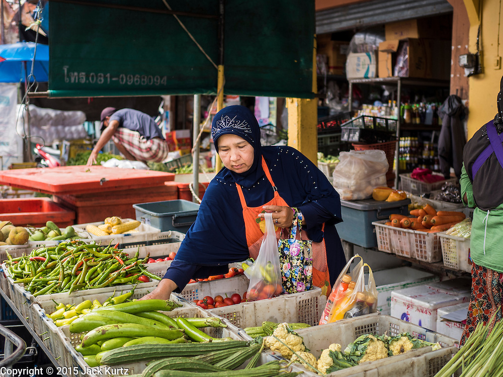 15 JUNE 2105 - NARATHIWAT, NARATHIWAT, THAILAND:  Shopping in the market in Narathiwat.      PHOTO BY JACK KURTZ