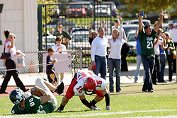 04 October 2008: Jack Scalcucci rolls over Andy Bures as he makes his way for a touchdown in a battle between the Carthage Red Men and the Illinois Wesleyan University Titans, Game action was at Wilder Field on the campus of Illinois Wesleyan University in Bloomington Illinois.