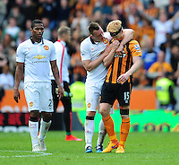 Manchester United's Phil Jones put his arm round Hull City's Paul McShane at the end of the game as his sides relegation from the Barclays Premiership is confirmed<br /> <br /> Photographer Chris Vaughan/CameraSport<br /> <br /> Football - Barclays Premiership - Hull City v Manchester United - Sunday 24th May 2015 - Kingston Communications Stadium - Hull<br /> <br /> © CameraSport - 43 Linden Ave. Countesthorpe. Leicester. England. LE8 5PG - Tel: +44 (0) 116 277 4147 - admin@camerasport.com - www.camerasport.com