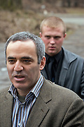 Yoshkar-Olinskii, Russia, 24/04/2005..A bodyguard looks on as Garry Kasparov arrives at a local residents' meeting in the Kazan area in central Russia. Kasparov has been forced to travel with a team of bodyguards after recently being attacked and beaten with a chessboard by a man posing as a fan. Kasparov, World Chess Champion for the last twenty years, recently retired from the professional game to devote his time to Russian politics, and is currently touring the country and founding a new political movement in opposition to President Valdimir Putin.