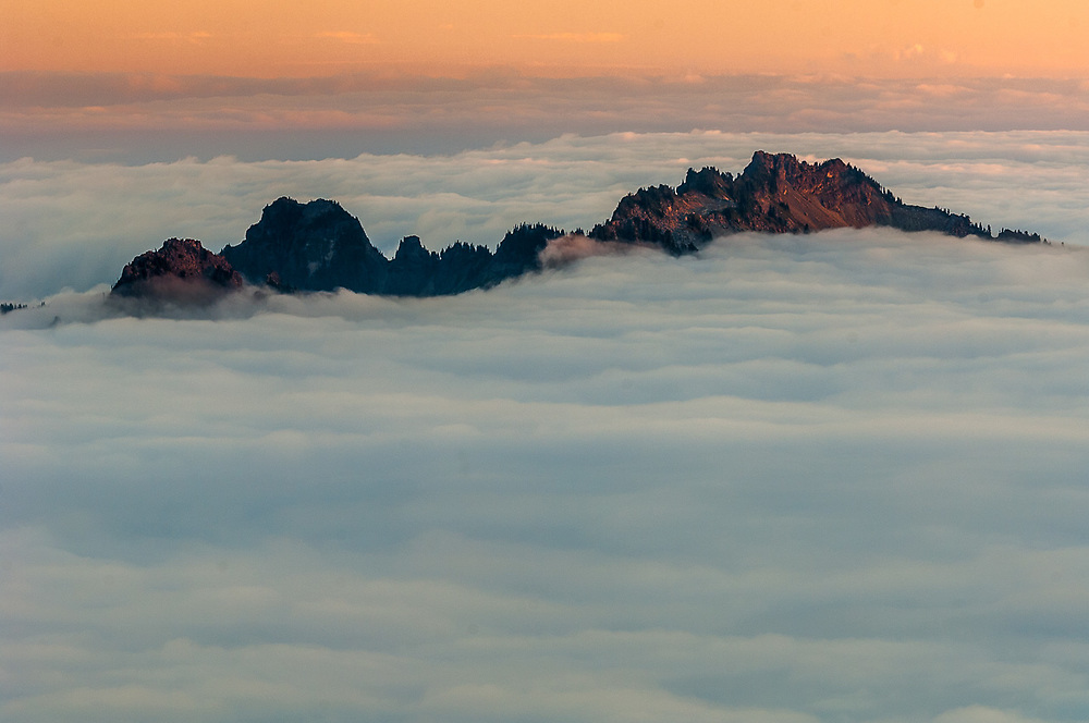 The Tatoosh Range and evening clouds, August, Nisqually River watershed, view from the Panorama Point area, Mount Rainier National Park, Washington, USA