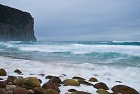 Waves crash along rocky shore at Rackwick bay on the island of Hoy, Orkney Islands, Scotland