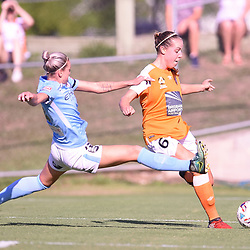 BRISBANE, AUSTRALIA - FEBRUARY 11: Alanna Kennedy of Melbourne attempts to block the cross from Celeste Boureille of the Roar during the Westfield W-League Semi Final match between the Brisbane Roar and Melbourne City at Perry Park on February 11, 2018 in Brisbane, Australia. (Photo by Patrick Kearney / Brisbane Roar)