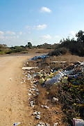 Building material and other trash discarded in the countryside