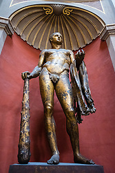 Vatican City Museum The bronze gilded cult statue of Hercules of the Theatre of Pompey in the Round Room, Sala Rotonda  Rome, Italy