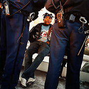 Police penalise a youngster who lied about his identity after being caught without a ticket at the Rai metro station in south Amsterdam. .Picture taken 2005 by Justin Jin