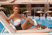The Danish-born actor, Brigitte Nielsen seen poolside at the Cannes Film Festival on 10th May 1992, at Cannes, France. Brigitte Nielsen born Gitte Nielsen; 15 July 1963 is a naturalised-Italian, Danish-born actress, model, singer and reality television personality who began her career modelling for Greg Gorman and Helmut Newton and several years later acted in the 1985 films Red Sonja and Rocky IV. She is also known for her marriage to Sylvester Stallone.