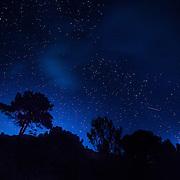 Stars awaken in the sky after moonset.