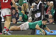 Tiernan O'Halloran scores a try for Ireland during the 2016 Guinness Series  autumn international rugby match, Ireland v Canada at the Aviva Stadium in Dublin, Ireland on Saturday 12th November 2016.<br /> pic by  John Halas, Andrew Orchard sports photography.