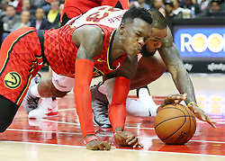 November 30, 2017 - Atlanta, GA, USA - Atlanta: Hawks guard Dennis Schroder grimaces as he collides with Cavaliers forward LeBron James while they battle for a loose ball during the second half in a NBA basketball game on Thursday, Nov. 30, 2017, in Atlanta. The Cavs beat the Hawks 121-114. (Credit Image: © Curtis Compton/TNS via ZUMA Wire)