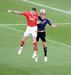 Bristol City's Aden Flint wins a high ball over West Ham's Andy Carroll - Photo mandatory by-line: Alex James/JMP - Mobile: 07966 386802 - 25/01/2015 - SPORT - Football - Bristol - Ashton Gate - Bristol City v West Ham United - FA Cup Fourth Round