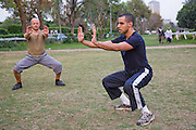 George Bahna (in black t-shirt), an engineering company executive and martial arts instructor  Kung Fu training and teaching a student at the Gezira Club in Zamelek, Cairo, Egypt.  (George Bahna is featured in the book What I Eat: Around the World in 80 Diets.) He is 29 years of age; 5 feet, 11 inches tall; and 165 pounds.