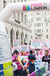 London, UK. 6 July, 2019. Activists from Lesbians and Gays Support The Migrants, African Rainbow Family, the Outside Project, Micro Rainbow and other LGBT+ groups take part in a London Pride Solidarity March at the very rear of Pride in London after storming the parade in solidarity with those for whom Pride in London is inaccessible and in protest against the corporatisation of Pride in London.