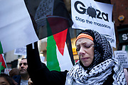 London, UK. Saturday 17th November 2012. Female protester cries as names of dead are read out. Demonstration against Israeli attacks on Gaza. Hundreds of Palestinians and Pro-Palestinians gathered to protest to gain freedom for Palestine and against Israel's recent shelling.