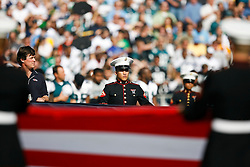 US Marine Corps members hold a large Amercial flag for the singing of the National Anthem before the NFL game between the Philadelphia Eagles and the San Diego Chargers on November 15th 2009. At Qualcomm Stadium in San Diego, California. (Photo By Brian Garfinkel)