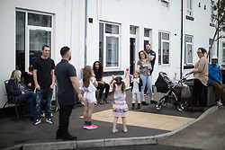 © Licensed to London News Pictures . 04/09/2017 . Manchester , UK . Children and families out playing in the street as Prince Harry visits the Walking With the Wounded ( WWTW) hub on Canada Street , Newton Health .  WWTW helps ex-service personnel with physical or mental health needs make the transition back to civilian life . The street was subject to an episode of DIY SOS when people gave their time and resource to help redevelop the houses . Photo credit : Joel Goodman/LNP