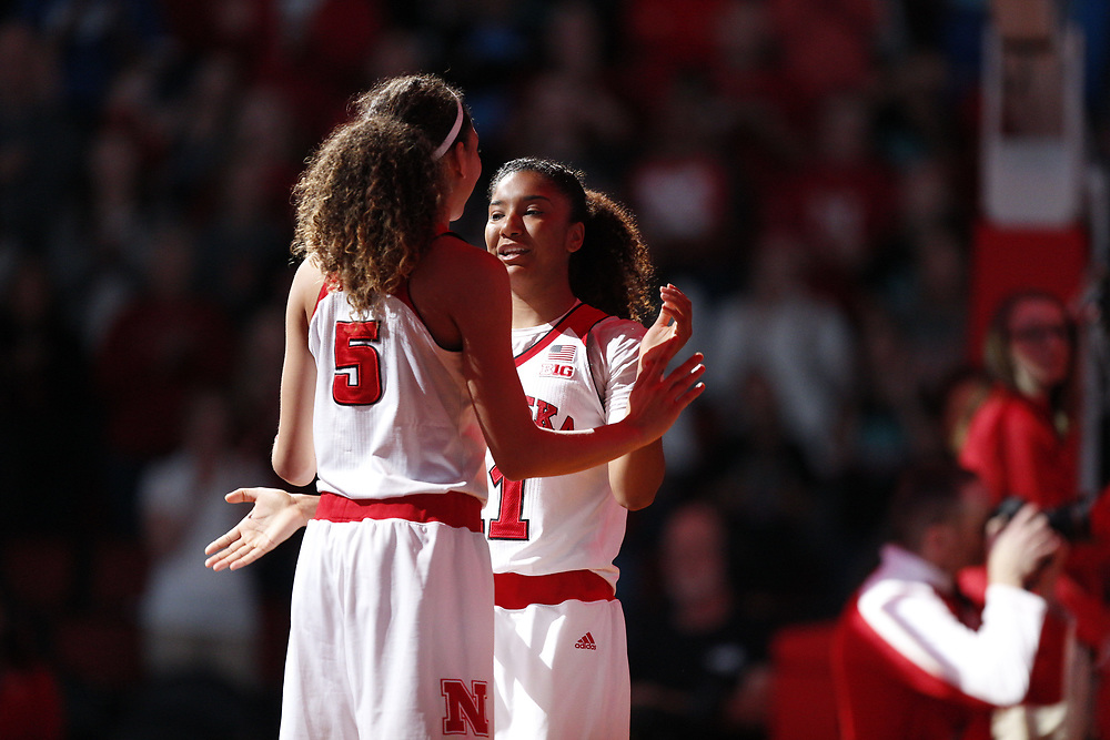 Nebraska Cornhuskers guard Nicea Eliely #5 and Nebraska Cornhuskers guard Esther Ramacieri #11 high five prior to Nebraska's 84-41 loss to No. 1-ranked UConn at Pinnacle Bank Arena in Lincoln, Neb. on Dec. 21, 2016. Photo by Aaron Babcock, Hail Varsity