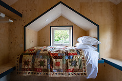 Bedroom of new wooden house at the Social Bite Village in Granton built by Social Bite organisation for homeless people, Edinburgh, Scotland, United Kingdom, UK