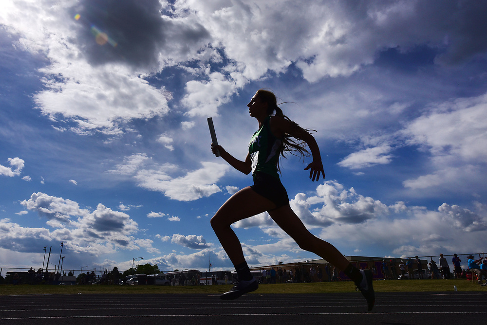 Belgrade High School's Pipi Eitel competes in the 1600 meter relay during the State A & C track and field meet at Laurel High School in Laurel, Montana on Friday, May 26, 2017. (Rebecca Noble/Billings Gazette)