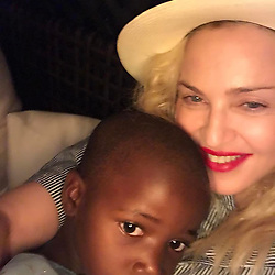 """Madonna releases a photo on Instagram with the following caption: """"Be Careful Who you Love\u2665\ufe0f\ud83c\uddf2\ud83c\uddfc\ud83c\udf3a! They might just love you back!! \u2665\ufe0f\ud83c\udf0d\ud83c\uddf2\ud83c\uddfc\ud83c\udf39\ud83d\ude4f\ud83c\udffb"""". Photo Credit: Instagram *** No USA Distribution *** For Editorial Use Only *** Not to be Published in Books or Photo Books ***  Please note: Fees charged by the agency are for the agency's services only, and do not, nor are they intended to, convey to the user any ownership of Copyright or License in the material. The agency does not claim any ownership including but not limited to Copyright or License in the attached material. By publishing this material you expressly agree to indemnify and to hold the agency and its directors, shareholders and employees harmless from any loss, claims, damages, demands, expenses (including legal fees), or any causes of action or allegation against the agency arising out of or connected in any way with publication of the material."""