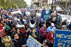 © Licensed to London News Pictures. 20/10/2018. LONDON, UK.  Signs carried aloft.  Thousands of people take part in a demonstration, organised by the People's Vote campaign, beginning with a march from Park Lane to a rally in Parliament Square.  The People's Vote seeks a referendum on the outcome of the final Brexit negotiations ahead of 29 March 2019, the date that the UK is due to leave the EU.  Photo credit: Stephen Chung/LNP