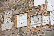Emblem tiles at the Old City Hall celebrating each year's wine vintage, Le Annate del Brunello, Montalcino, Val D'Orcia,Tuscany, Italy RESERVED USE - NOT FOR DOWNLOAD - FOR USE CONTACT TIM GRAHAM