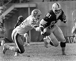Raiders vs. SF 49ers...niner Tony Dungy tries to tackle Raider Morris Bradshaw..(1979 photo/Ron Riesterer)