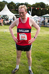 © Licensed to London News Pictures . 30/07/2015 . Ambleside , UK . TIM FARRON , newly elected leader of the Liberal Democrat Party in the UK and MP for Westmorland and Lonsdale , after running in a fell race in the Lake District National Park . Photo credit: Joel Goodman/LNP