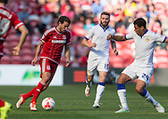 Middlesbrough FC striker Christian Stuani  holds the ball from Leeds United FC midfielder Tom Adeyemi   during the Sky Bet Championship match between Middlesbrough and Leeds United at the Riverside Stadium, Middlesbrough, England on 27 September 2015. Photo by George Ledger.