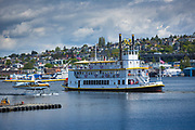 Tour boat on Seattle's Lake Union, with seaplane next to it