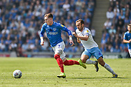 Portsmouth Midfielder, Ronan Curtis (11) gets away from Coventry City Midfielder, Liam Kelly (6) during the EFL Sky Bet League 1 match between Portsmouth and Coventry City at Fratton Park, Portsmouth, England on 22 April 2019.