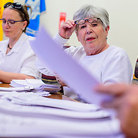042115       Cable Hoover<br /> <br /> Precinct official Gail Satermo lifts her glasses to read one ballot as she and her colleagues recount the early voting ballots of the Gallup mayoral election Tuesday at City Hall.