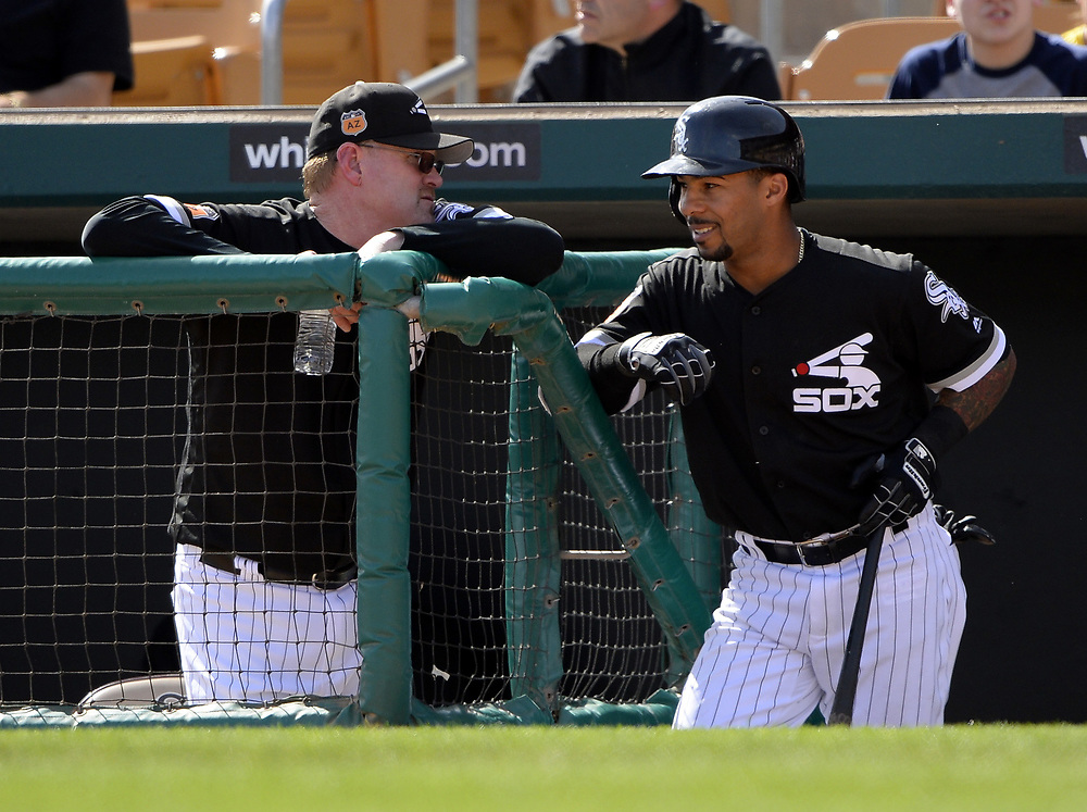 GLENDALE, ARIZONA - MARCH 4:  Assistant hitting coach Greg Sparks #46 (L) talks with Leury Garcia #28 of the Chicago White Sox during the spring training game against the Los Angeles Angels of Anaheim on March 4, 2017 at Camelback Ranch in Glendale Arizona.  (Photo by Ron Vesely)   Subject:  Greg Sparks; Leury Garcia