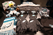 A pile of team merchandise, including NFC East Divisional Champion hats, is ready for sale before the Philadelphia Eagles NFL NFC Wild Card football game against the New Orleans Saints on Saturday, Jan. 4, 2014 in Philadelphia. ©Paul Anthony Spinelli
