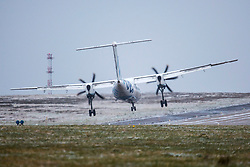 © Licensed to London News Pictures. 17/03/2018. Leeds UK. A Flybe aircraft struggles to land at Leeds Bradford airport this morning in strong cross winds as the Beast from the East 2 start's to batter Britain. Photo credit: Andrew McCaren/LNP