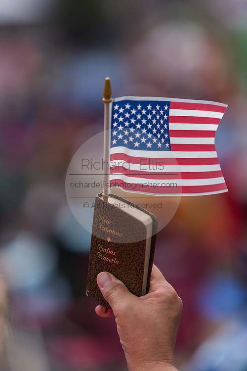"""An Evangelical Christian holds a bible and flag during the """"Stand With God"""" rally  August 29, 2015 in Columbia, SC. Thousands of conservative Christians gathered at the State House to rally against gay marriage and listen to GOP presidential candidates Gov. Rick Perry and Sen. Ted Cruz speak."""