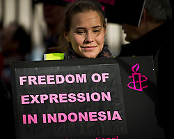 © London News Pictures. 31/10/2012. London, UK.  A woman holding  a banner during a protest outside Downing Street, London against alleged human rights abuses committed by Indonesia's government against West Papuan tribespeople. The President of Indonesia, Susilo Bambang Yudhoyono, is currently on a state visit to the UK.  Photo credit: Ben Cawthra/LNP
