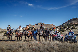 Group photo of cowboys working bison roundup, Ladder Ranch, west of Truth or Consequences, New Mexico, USA.
