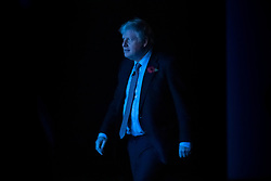 © Licensed to London News Pictures. 06/11/2019. Birmingham, UK. Prime Minister Boris Johnson is bathed in blue light before he launches the Conservative Party election campaign at the NEC in Birmingham. Today is the first official day of the 2019 general election. Voters go to the polls on December 12th 2019. Photo credit: Peter Macdiarmid/LNP