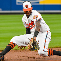 BALTIMORE, MD - AUGUST 01:  Baltimore Orioles shortstop Tim Beckham (1) fields a ground ball during an MLB game between the Kansas City Royals and the Baltimore Orioles on August 1, 2017, at Orioles Park at Camden Yards in Baltimore, MD.  (Photo by Mark Goldman/Icon Sportswire)