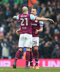 Aston Villa's John Terry (facing) and Alan Hutton celebrate after the final whistle