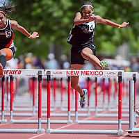 Navajo Prep Eagle Monty Larvingo chases down a third-place finish in the 100 meter hurdles during the New Mexico State track and field meet in Albuquerque Saturday.